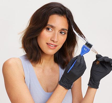 Brunette applying highlights on hair